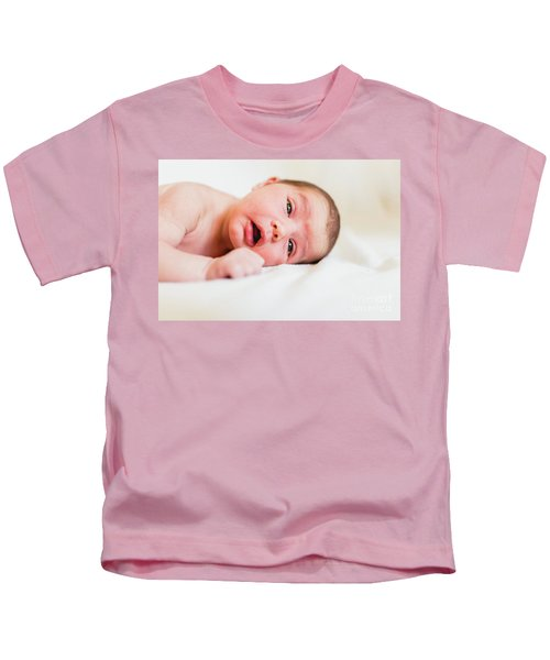 Portrait Of Newborn Baby Girl Feels Safe And Awake To A New Life. Kids T-Shirt
