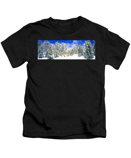 Pine Trees On A Snow Covered Hill Kids T-Shirt