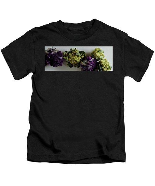 A Group Of Cauliflower Heads Kids T-Shirt by Romulo Yanes