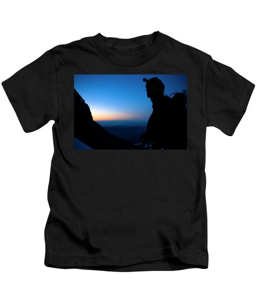 A Man Looks Up At The Summit Of Mount Kids T-Shirt