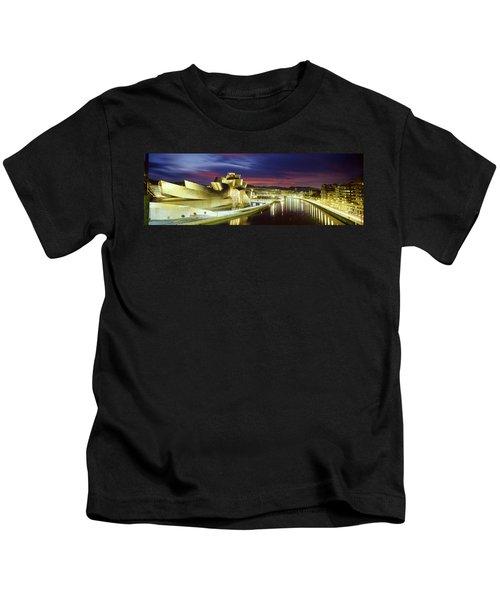 Buildings Lit Up At Dusk, Guggenheim Kids T-Shirt