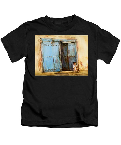 Child Sitting In Old Zanzibar Doorway Kids T-Shirt