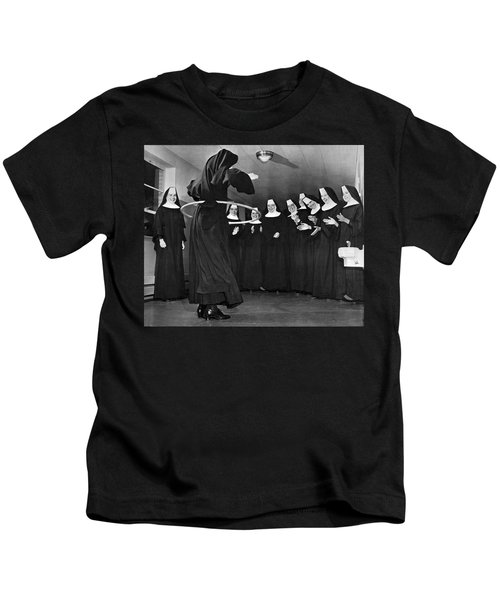 Nun Swivels Hula Hoop On Hips Kids T-Shirt