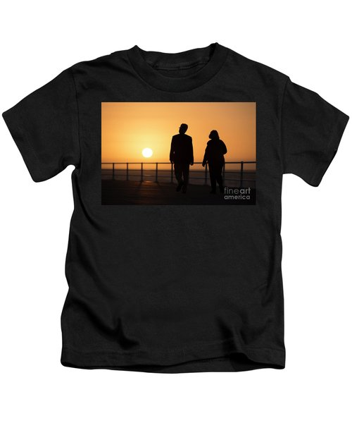 A Couple In Silhouette Walking Into The Sunset Kids T-Shirt