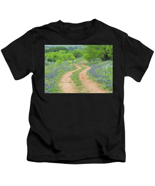 A Dirt Road Lined By Blue Bonnets Of Texas Kids T-Shirt