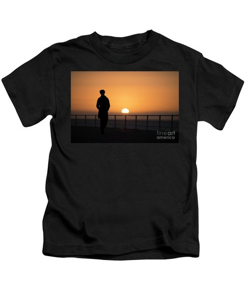 A Woman Silhouetted At Sunset Kids T-Shirt