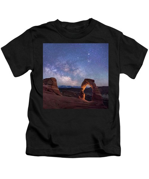 Delicate Arch Under The Starry Sky In Arches National Park Panorama  Kids T-Shirt