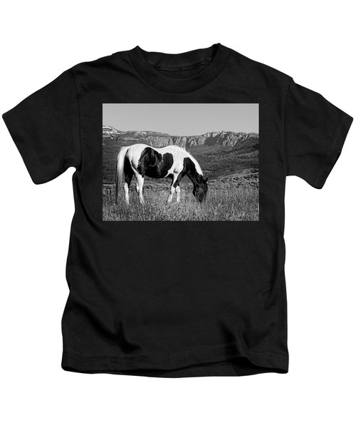 Black And White Horse Grazing In Wyoming In Black And White  Kids T-Shirt