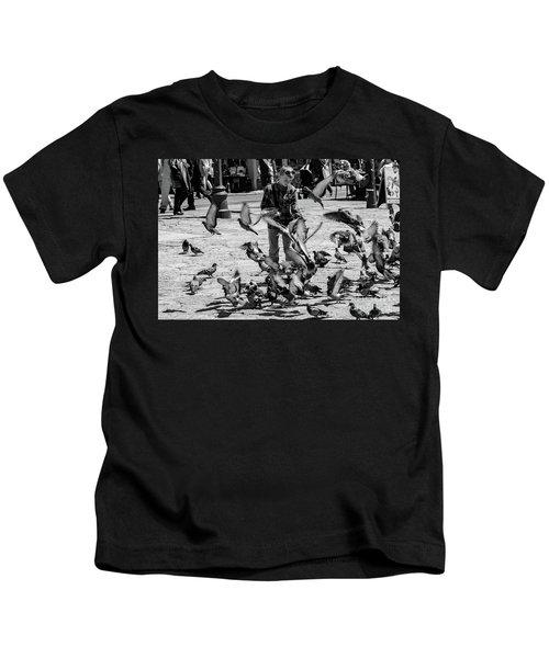 Black And White Of Boy Feeding Pigeons In Sarajevo, Bosnia And Herzegovina  Kids T-Shirt