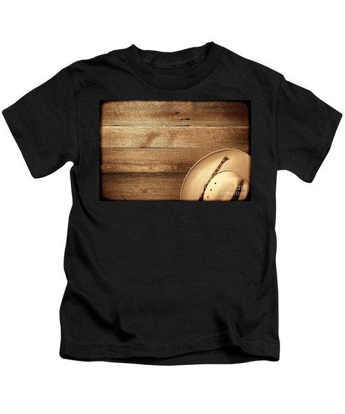 Cowboy Hat On Wood Table Kids T-Shirt