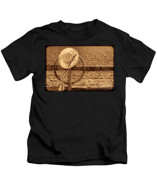Hat And Lasso On A Fence Kids T-Shirt
