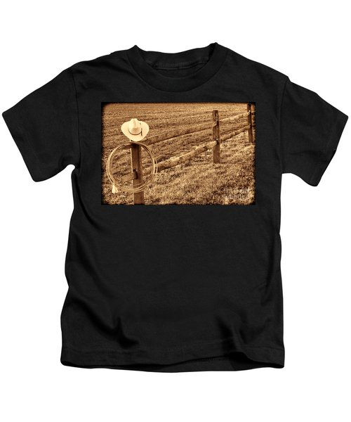 Hat And Lasso On Fence Kids T-Shirt