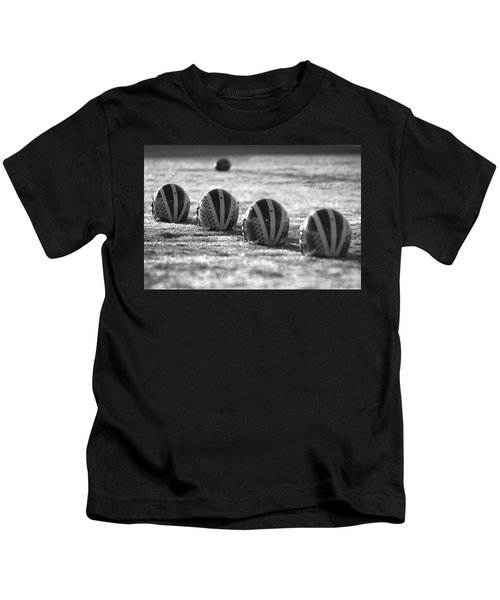Helmets On Dew-covered Field At Dawn Black And White Kids T-Shirt