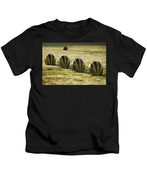 Helmets On Dew-covered Field At Dawn Kids T-Shirt