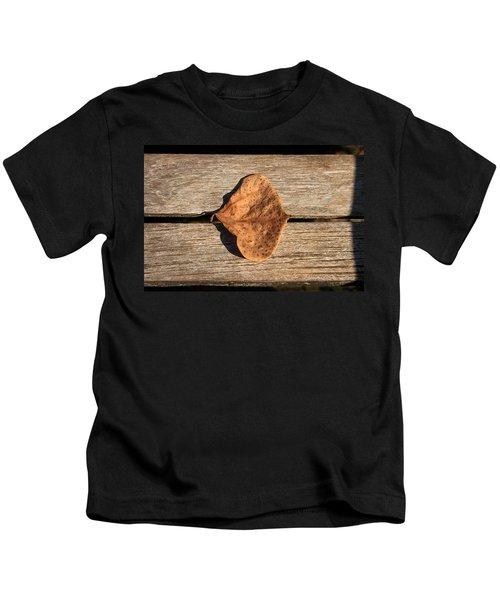 Leaf On Wooden Plank Kids T-Shirt