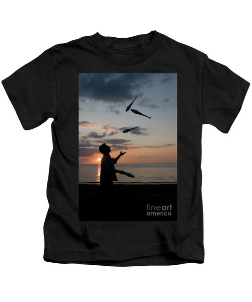 Man Juggling With Four Clubs At Sunset Kids T-Shirt