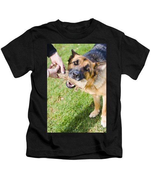 Pet Dog In Park Playing Tug Of War Game With Owner Kids T-Shirt