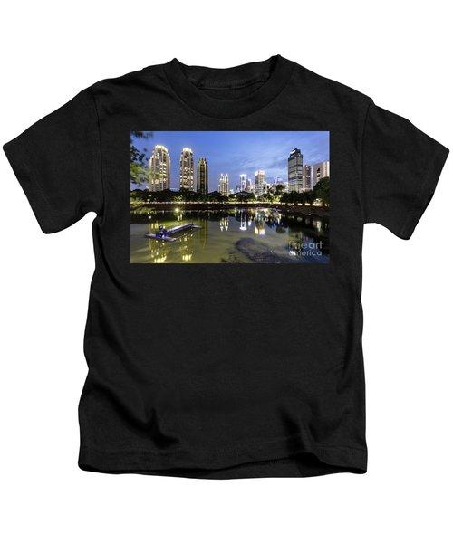 Reflection Of Jakarta Business District Skyline During Blue Hour Kids T-Shirt