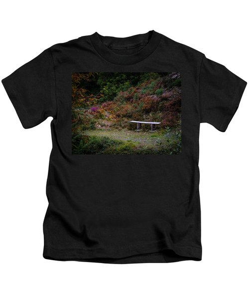 Kids T-Shirt featuring the photograph Rustic Bench In The Autumn Irish Countryside by James Truett
