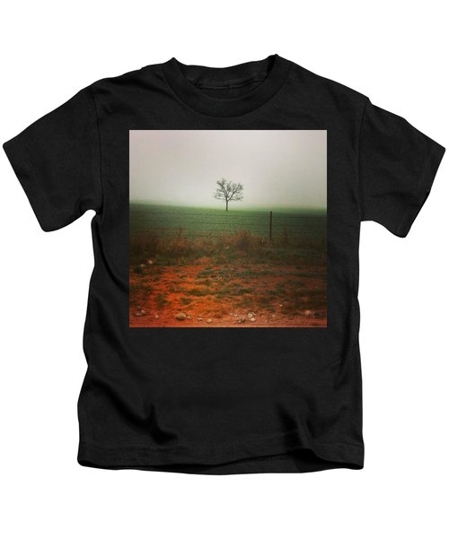 Standing Alone, A Lone Tree In The Fog. Kids T-Shirt