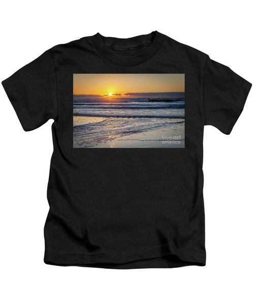 Sun Behind Clouds With Beach And Waves In The Foreground Kids T-Shirt