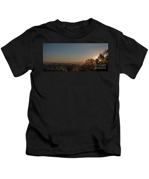 Sunset Behind Tree With Forest And Mountains In The Background Kids T-Shirt