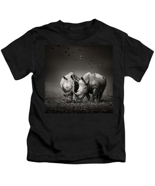 Two Rhinoceros With Birds In Bw Kids T-Shirt