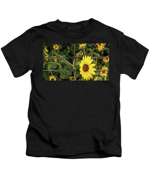 Yellow Flower Escaping From A Barb Wire Fence Kids T-Shirt
