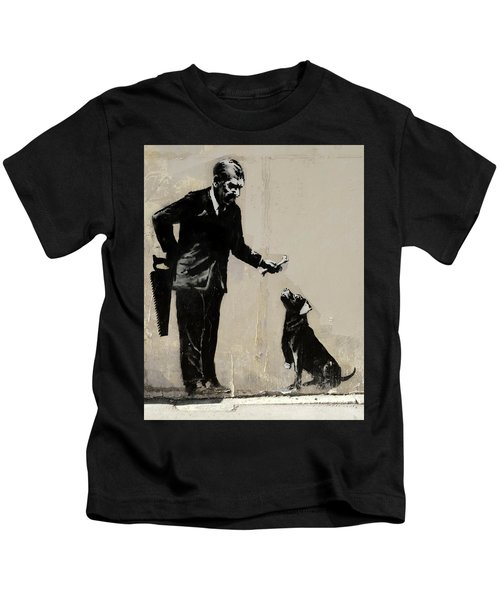 Kids T-Shirt featuring the photograph Banksy Paris Man With Bone And Dog by Gigi Ebert
