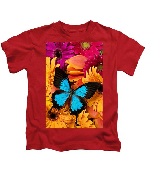 Blue Butterfly On Brightly Colored Flowers Kids T-Shirt