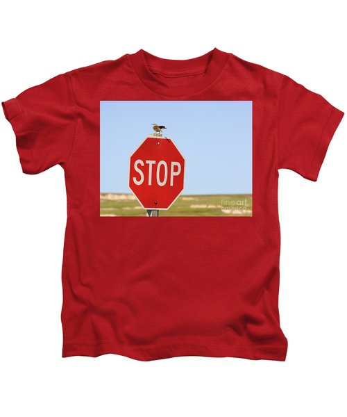 Western Meadowlark Singing On Top Of A Stop Sign Kids T-Shirt by Louise Heusinkveld
