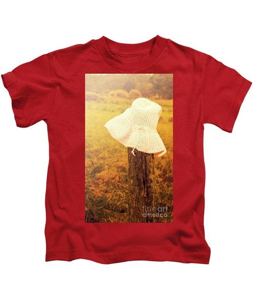 White Knitted Hat On Farm Fence Kids T-Shirt