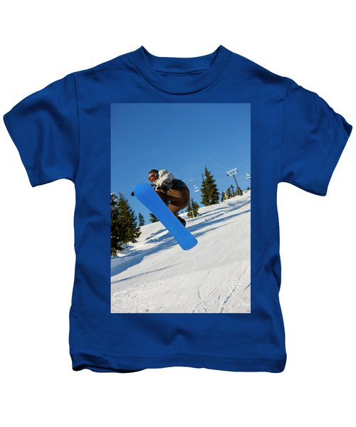 A Snowboarder Does A High Flying Ariel Kids T-Shirt