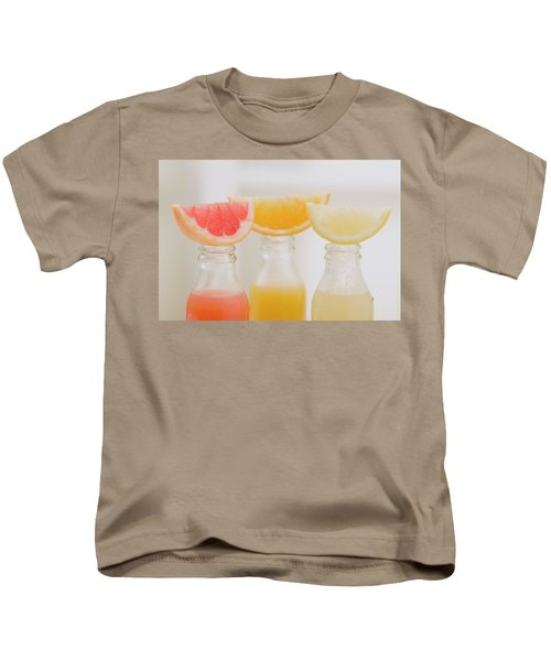 Three Fruit Juices In Bottles With Wedges Of Fresh Fruit Kids T-Shirt