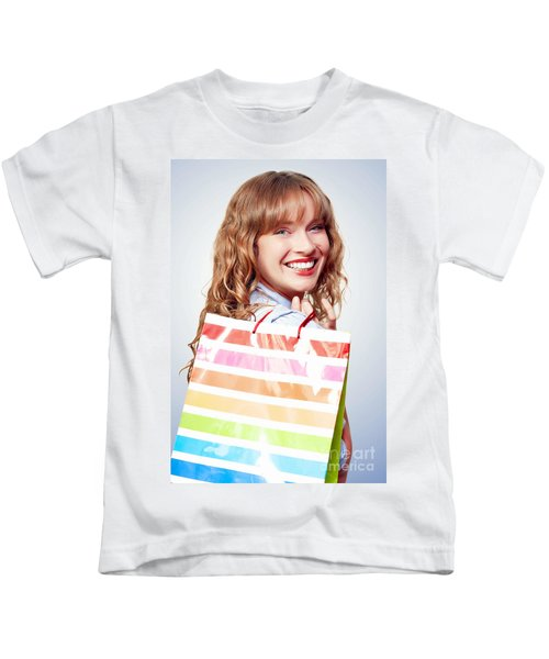 Happy Female Retail Shopper With Bag And Smile Kids T-Shirt