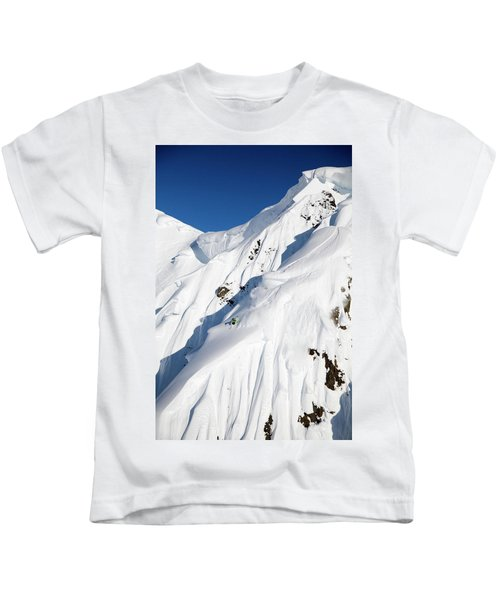 A Male Skier Skis A Big First Descent Kids T-Shirt