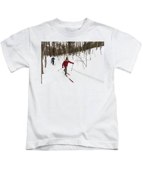 A Man And Woman Cross Country Skiing Kids T-Shirt
