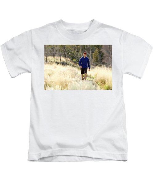 A Man In A Blue Jacket Walks Kids T-Shirt