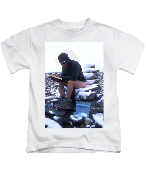 A Man Reads While Using A Snow-covered Kids T-Shirt