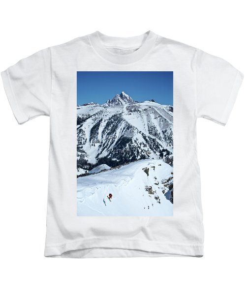 A Man Skiing A Steep Slope Kids T-Shirt