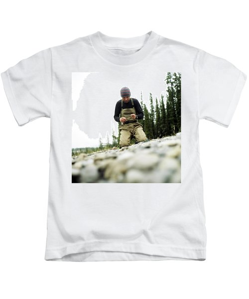 A Man Ties A Fly Beside The Bow River Kids T-Shirt