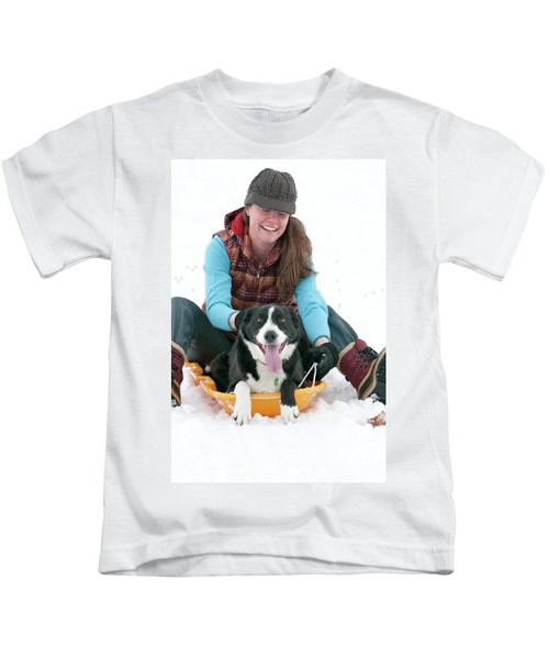 A Smiling Young Woman Rides A Sled Kids T-Shirt