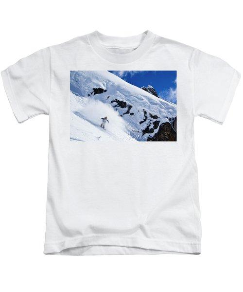 A Snowboarder Slashes Powder Snow Kids T-Shirt