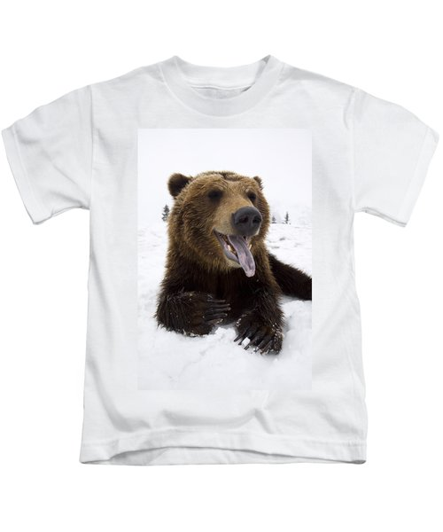 Captive Brown Bear Resting In Snow At Kids T-Shirt