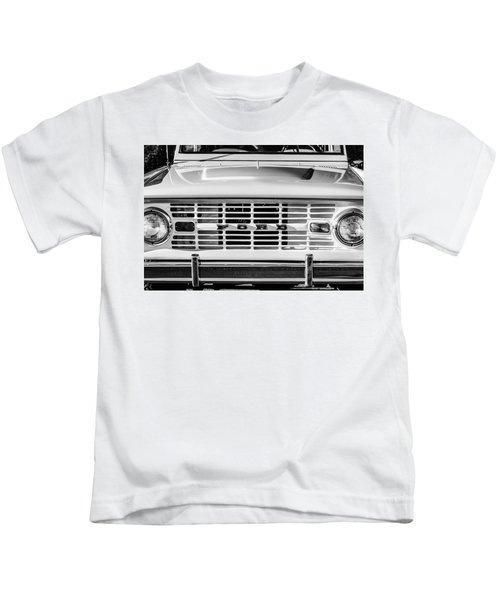 Kids T-Shirt featuring the photograph Ford Bronco Grille Emblem -0014bw by Jill Reger
