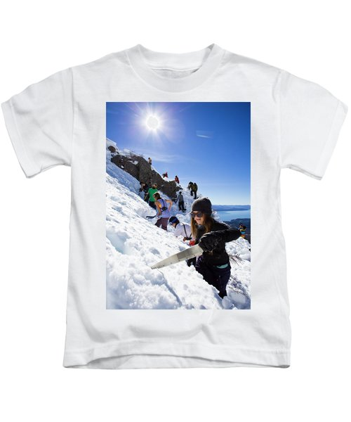 Professional Skier Using A Snow Saw Kids T-Shirt