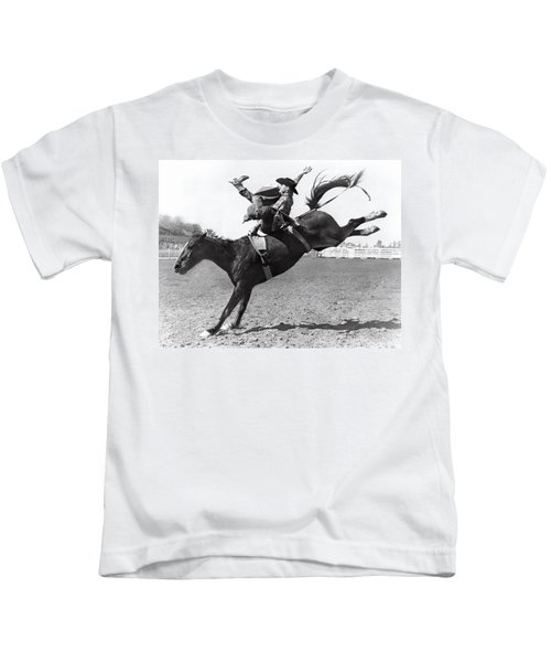 Riding A Bucking Bronco Kids T-Shirt