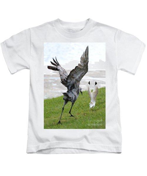 Sandhill Chasing Ibis Kids T-Shirt by Carol Groenen