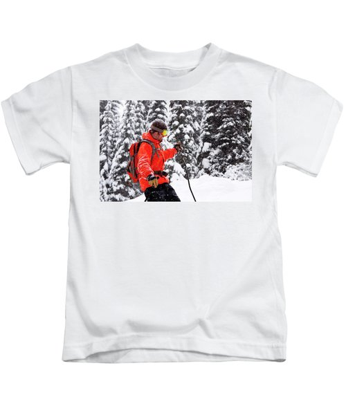 Smiling Male Skier On A Snowy Landscape Kids T-Shirt