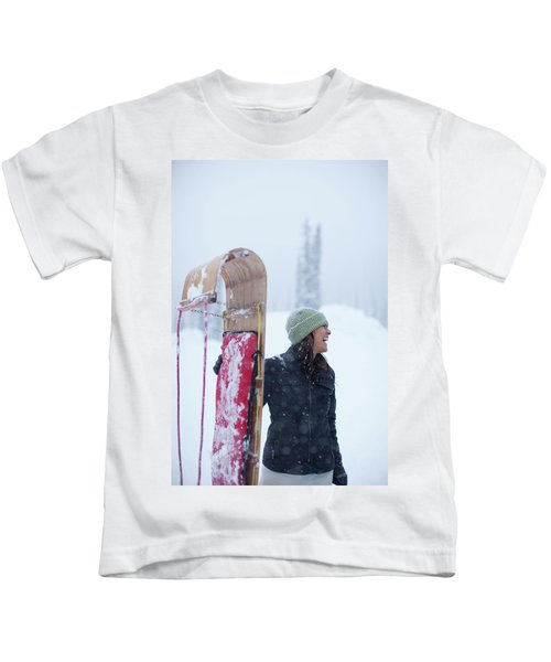 Woman Standing With Toboggan Sled Kids T-Shirt